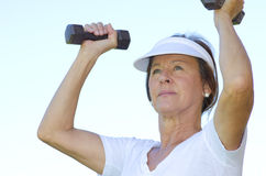 Mature woman lifting weights II Stock Photography