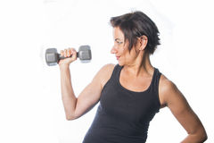 Mature woman lifting weights Royalty Free Stock Photo