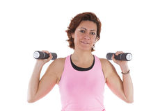 Mature woman lifting weights Royalty Free Stock Photos