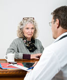 Mature Woman Listening to Her Doctor Stock Images