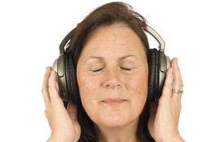 Mature Woman Listening To Music Royalty Free Stock Photography