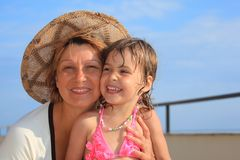 Mature woman with little girl on veranda Royalty Free Stock Photos