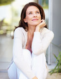 Mature woman looking away day dreaming Stock Images