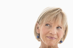 Mature Woman Looking Away Over White Background Royalty Free Stock Photography