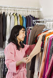 Mature woman Looking at Brown Sweater Stock Photos
