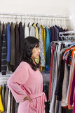Mature woman looking at clothing Stock Photo