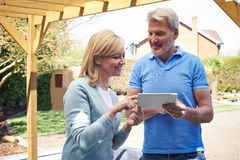 Mature Woman Looking At Design On Digital Tablet With Landscape Royalty Free Stock Photo