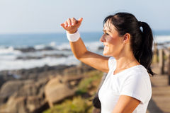 Mature woman looking distance. Fit mature woman looking into distance at beach in the morning Royalty Free Stock Images