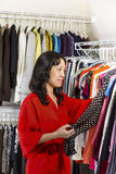 Mature woman looking at Dress Top in Morning Stock Photos