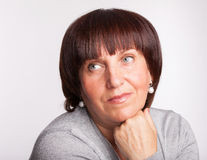 Mature woman looking inside Stock Image