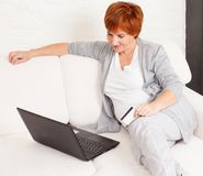 Mature woman looking at the laptop Stock Photo
