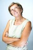 Mature woman looking up Royalty Free Stock Photos