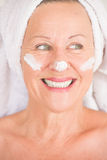 Mature Woman with lotion on face Royalty Free Stock Image
