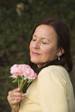 Mature Woman in love with rose Stock Photos