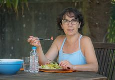 Mature woman lunch in the garden Stock Images