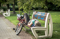 Mature woman lying on bench Stock Photography