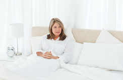 Mature woman  lying down in her bed Royalty Free Stock Images