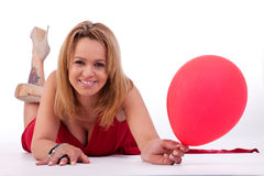 Mature woman lying, holding a ballon Stock Image