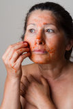 Mature woman making cosmetic mask Royalty Free Stock Photography