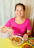 Mature woman making  dough Royalty Free Stock Images