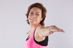 Mature woman making exercise Royalty Free Stock Photography