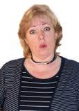 Mature woman making face Royalty Free Stock Image