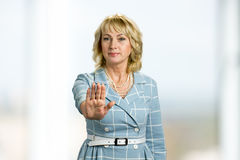 Mature woman making gesture stop. Stock Photo