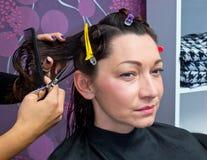 Mature woman making new haircut Royalty Free Stock Images
