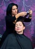 Mature woman making new haircut Royalty Free Stock Image