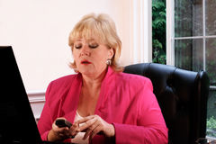 Mature woman making phone call Royalty Free Stock Photo