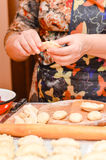 Mature woman making traditional vareniki or ravioli closeup Stock Photography