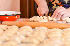 Mature woman making traditional vareniki or ravioli closeup Stock Images