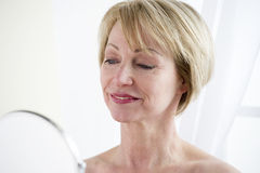 Mature Woman Making Up Stock Images