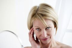 Mature Woman Making Up Stock Photo