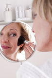Mature Woman Making Up. Close-up Royalty Free Stock Photo