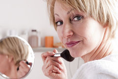Mature Woman Making Up. Mature Beautiful Woman Making Up Royalty Free Stock Images