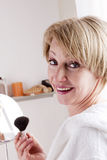 Mature Woman Making Up. Mature beautiful Woman Making Up Royalty Free Stock Image