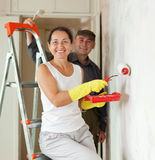 Mature woman and man making repairs Royalty Free Stock Images