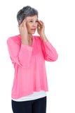 Mature woman massaging head Stock Images