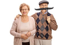 Mature woman and a mature man with big fake moustache Royalty Free Stock Images