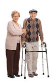 Mature woman and a mature man with a walker Royalty Free Stock Images