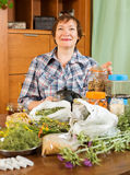 Mature woman with medicinal herbs Stock Images