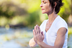 Mature woman meditation stock photos