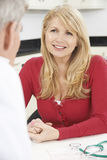 Mature Woman Meeting With Doctor In Surgery Stock Photography