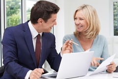 Mature Woman Meeting With Financial Advisor At Home Royalty Free Stock Photography
