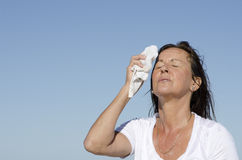 Mature woman menopause stress sweating Royalty Free Stock Photos
