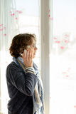 A mature woman with a mobile phone Royalty Free Stock Photography