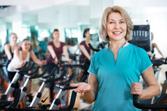 Mature woman in modern gym Royalty Free Stock Photo