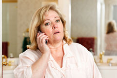 Mature woman morning call Royalty Free Stock Image