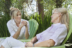 Mature woman and mother having a quality time at park Royalty Free Stock Images